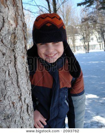 Boy Near A Tree.