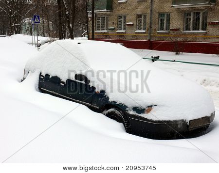 Car In Snowdrift After Snowfall In Moscow