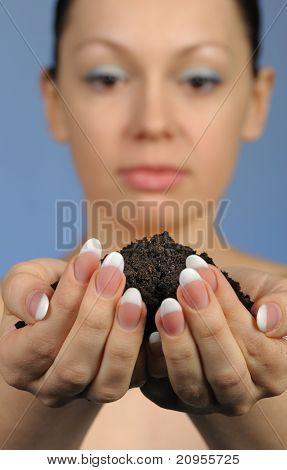 The Girl Holds In Hands Soil