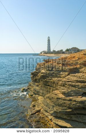 Lighthouse, Sea And Rock