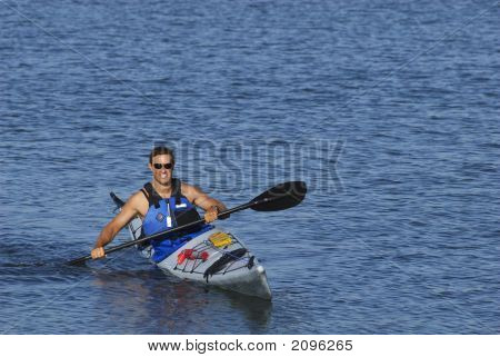 Athletic Man Showing Off His Kayaking Skills