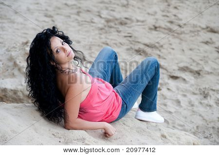 Young European Girl On Rocks
