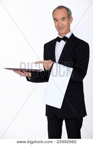 60 years old waiter showing his trail