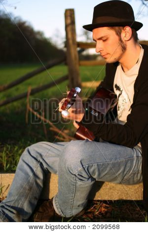 Guitarist In Sunset