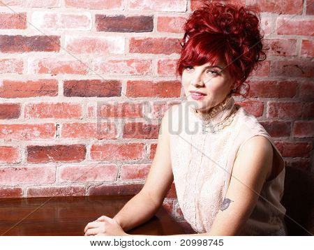 Woman and brick wall