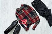 Checkered Top With Sleeves, Jeans Snd Black Shoes. Maple Leaf. Fashionable Concept. poster