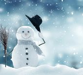 New year greeting card with copy-space.Happy snowman standing in christmas landscape.Snow background poster