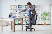 Businessman having fun taking a break in the office at work poster