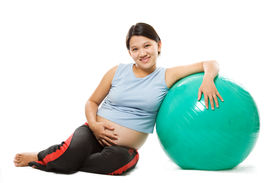 pic of pregnancy exercises  - A shot of a beautiful pregnant woman with an exercise ball - JPG