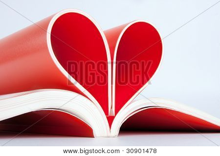 Close-up of book pages folded into a heart shape