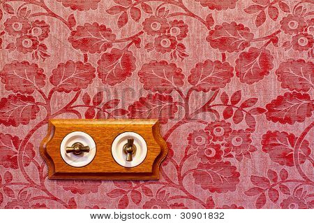 Antique wooden light switch on the wall