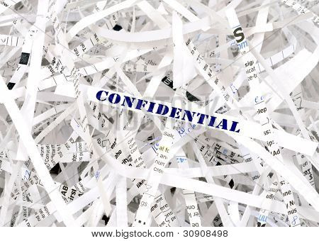 Confidential text surrounded by shredded paper. Great concept for information protection