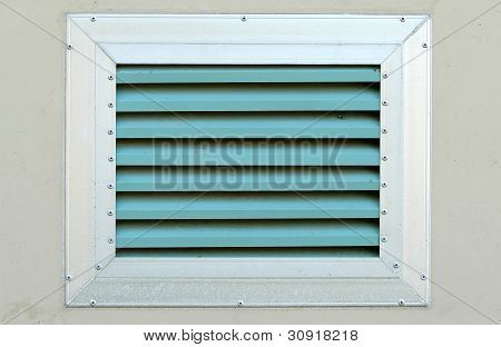 An Industrial Ventilation Fan Attached To A Building
