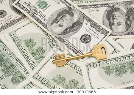 Golden Key On Money Background