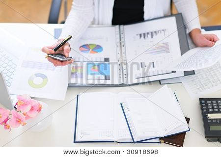 Closeup On Office Table And Working Business Woman