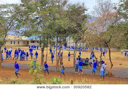 Unidentified children play in school yard