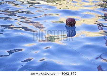 Ball Floating In Pool