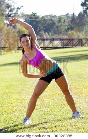 Beautiful Brunette Ahtlete Stretches Outdoors (4)