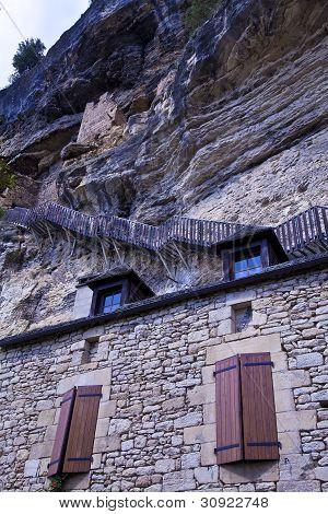 Steep wooden steps hug the cliffs above the village of La Roque-Gageac
