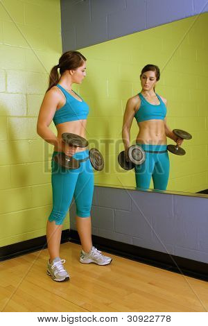 Beautiful Woman With Hand Weights (1)