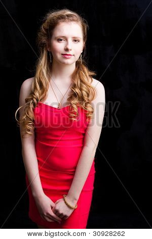 Attractive Young Girl Wearing Red Dress On Black