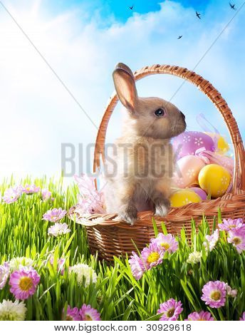 Easter Basket With Decorated Eggs And The Easter Bunny