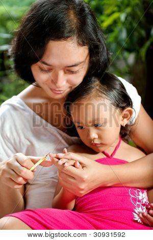 Mother Cutting Child Fingernail