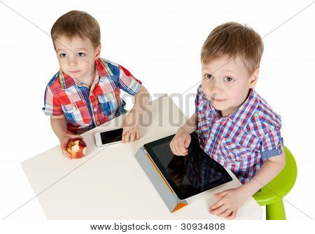 Two Brothers With A Tablet Pc