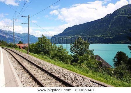 Railway track in Switzerland next to a lake