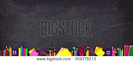 poster of School Supplies Bottom Border Banner. Top View On A Chalkboard Background With Copy Space. Back To S