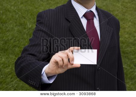 Businessman Showing A Blank Card