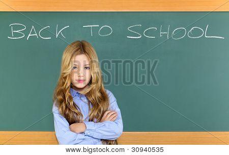 kid student girl on green school blackboard with written back to school text