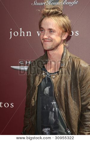 LOS ANGELES - MAR 11:  Tom Felton arrives at the 9th Annual John Varvatos Stuart House Benefit at the John Varvatos Store on March 11, 2012 in West Hollywood, CA
