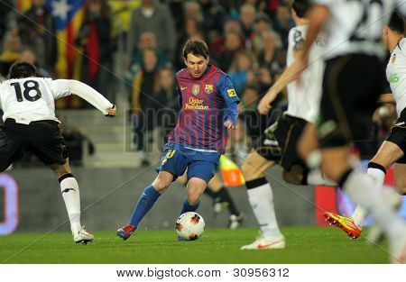 BARCELONA - FEB, 19: Leo Messi of FC Barcelona in action during the Spanish league match against Valencia CF at the Camp Nou stadium on February 19, 2012 in Barcelona, Spain