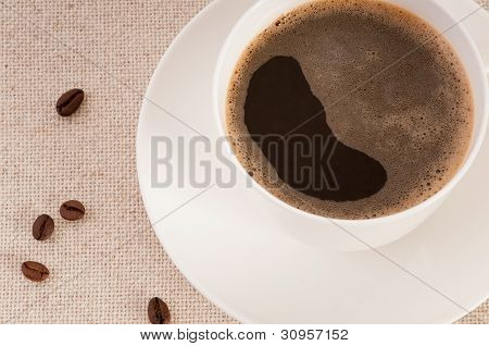 White Cup With Black Coffee And Beans On Canvas