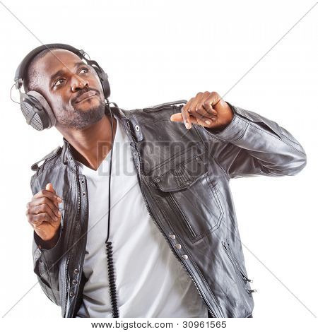 Young black man listening to music over his headphones.
