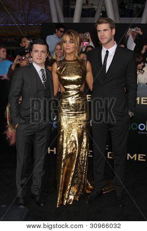 LOS ANGELES - MAR 12:  Josh Hutcherson; Jennifer Lawrence; Liam Hemsworth arrives at the