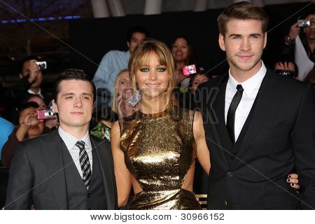 "LOS ANGELES - MAR 12:  Josh Hutcherson; Jennifer Lawrence; Liam Hemsworth arrives at the ""Hunger Games"" Premiere at the Nokia Theater at LA Live on March 12, 2012 in Los Angeles, CA"