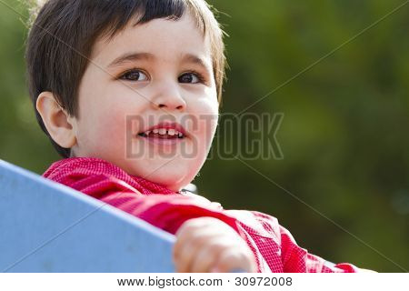 Cute european baby boy playing at park