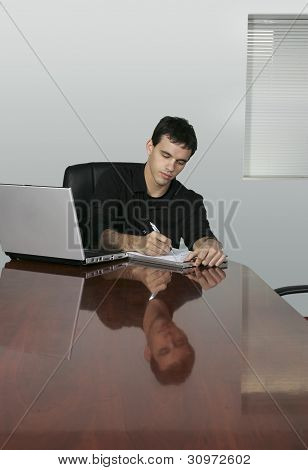Business Man In Office Writing