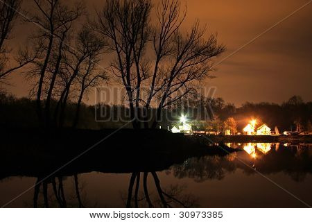 Buildings on the water at night