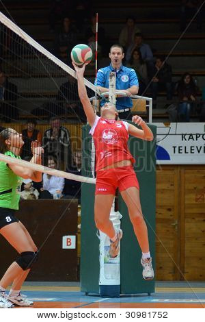 KAPOSVAR, HUNGARY - FEBRUARY 3: Zsofia Horvath (red 5) in action at the Hungarian Championship volleyball game Kaposvar (red) vs Miskolc (green), February 3, 2012 in Kaposvar, Hungary