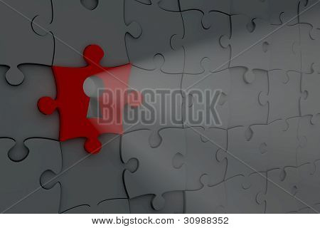 Light shining though a keyhole in a red jigsaw puzzle piece