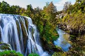 Scenic waterfall cascades on the river Sluncica. Magnificent Southern Europe, Croatia, small town Sl poster