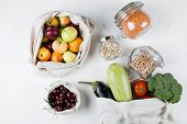 Zero Waste Food Storage Eco Bag Top View. Reusable Cotton Bag With Fresh Vegerables, Fruits, Berry,  poster