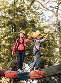 Child Playing On The Playground. Balance Beam And Rope Bridges. Go Ape Adventure. Hiking In The Rope poster