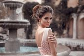 Beautiful Bride With Pearl Earrings Jewelry Wears Pink Prom Dress. Outdoor Romantic Portrait  Of Att poster