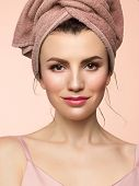 Beauty Close-up With Day Makeup. Pure, Radiant Skin Of The Face, A Towel On His Head And A Slight Pl poster