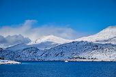 Fishing ship boat in Norwegian fjord in winter. Lofoten islands, Norway poster