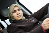 picture of niqab  - Arabic Muslim woman driving car wearing traditional scarf - JPG